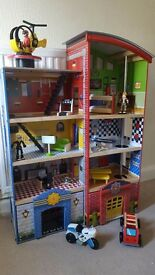 Wooden police/fire station dolls house