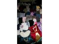 Bundle of girl's clothes and shoes. Various sizes, items and brands.