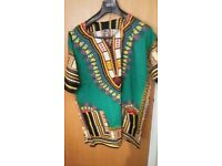 Dashiki pride dresses and tops for women, tops for men in different colours.
