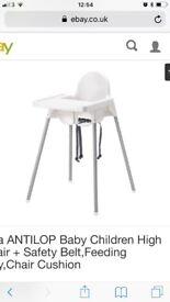 Ikea high chair in white.