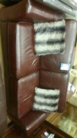 Reddish brown leather sofa in excellent condition