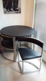 Black round table & 4 chairs. Great for small spaces. £90. Collection only, Norfolk Road, Brighton