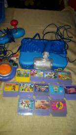 Vtech smile console with 12 games, microphone, 2 controllers & dance mat