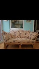 Cane conservatory furniture, 2 seater settee, 1 chair and a glass top table.