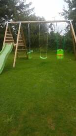 Set wooden swings an slide with seesaw
