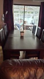 Modern solid dark wood extending dining table & 6 high back chairs