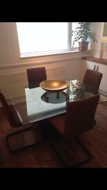 Square smoked glass dining table with marble base