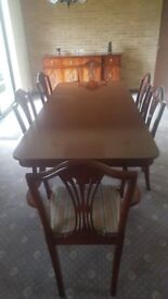 Regency style mahogany extending dining room table and six chairs