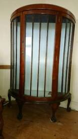 Wooden display cabinet with glass shelves