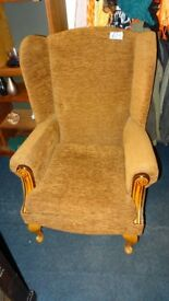brown wingback armchair