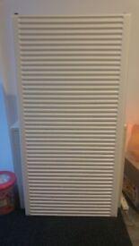 BRAND NEW white radiator 120cm x 63cm approximately