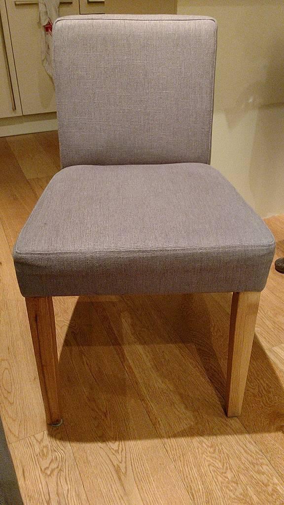 Pair of grey covered dinning chairs, oak veneer legs