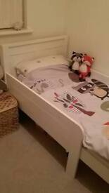 Extendable childrens white bed with safety sides
