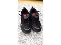 Boys or girls black genuine Heelys UK Size 4.