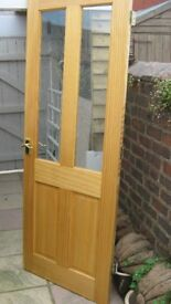 Internal half-glazed pine door with fittings. Used but good overall condition.
