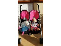 Childs toy double buggy + baby born boy doll