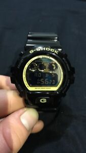 Brand new black and gold casio g-shock digital watch