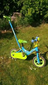 Child's first bike with steering handle and stabilisers