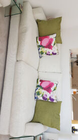 Sofa and two arm chairs in cream