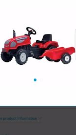 Brand new in box pedal tractor and trailer!
