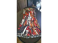 Designer sleeveless dress in size 8