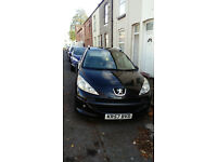 Peugeot 207 SW 1.4 petrol 5dr,black .new mot.just serviced,panoramic glass roof.