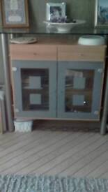 Display cabinet with drawers and lights