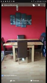 Oak extending dining table with 4 faux leather chairs