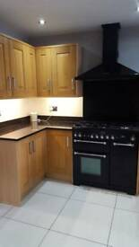Oak kitchen with granite work top and appliances