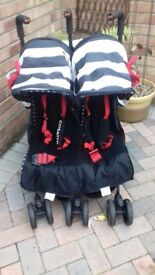 Lightweight double buggy, excellent condition. All accessories included