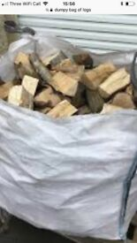 Dumpy bag of mixed seasoned logs . Free delivery