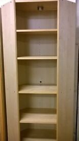 Tall, light wood, shelving unit
