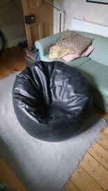 Large black leather effect bean bag