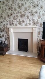 Fireplace surround with stone backing and hearth. Excellent condition. Gas fire included.