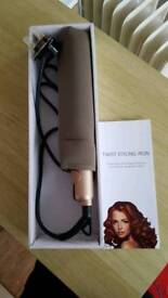 Twist styling iron