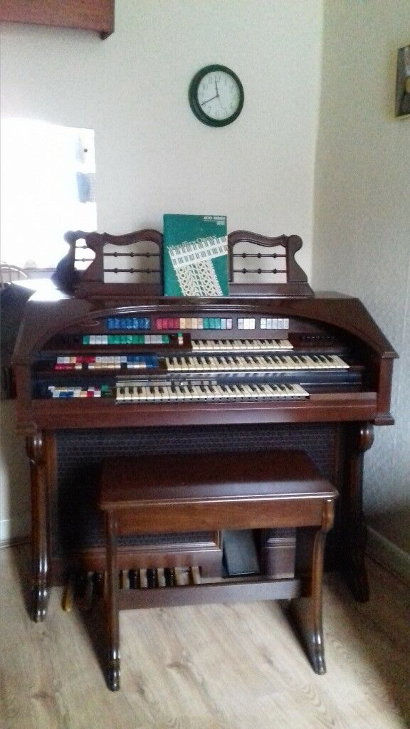 Wurlitzer Organ, fully functional, excellent condition, matching stool and instruction books.