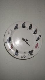Ceramic cat clock
