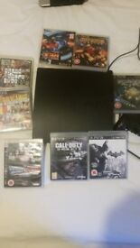 sony ps3 with controller and games