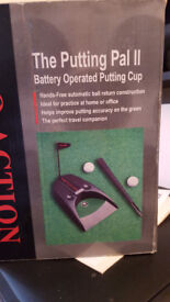 Battery operated putting cup