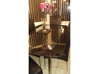 Black glass dining table with 6 leather chairs