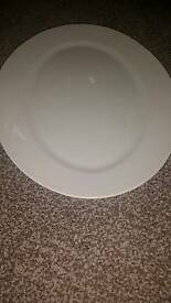 2 oblong plates and 3 large round plates