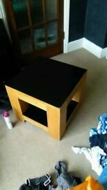 Coffee table with black leather top and bottom