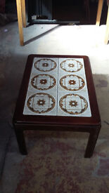 dark brown wood coffee table with light brown patterned tiles at the top