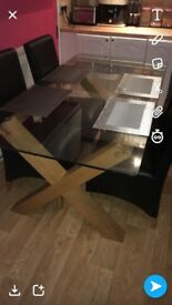 Beautiful table with 4 chairs lovely condition. Only selling as buying a smaller one.