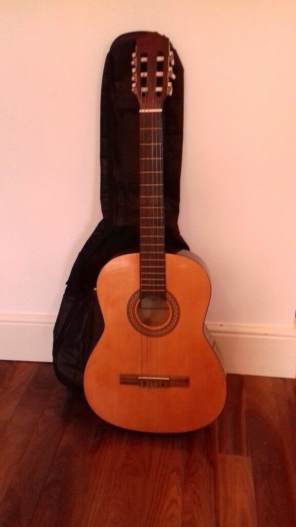 Classical guitar with soft shell case