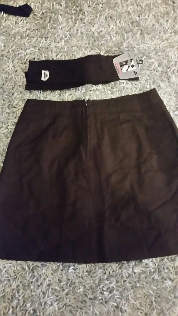 Brown school skirt size 29ins waist and 74 cm pair of school socks knee high 4 to 6 and s half