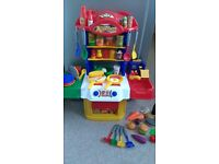 Childrens play kitchen with accessories