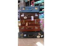Job lot of five suitcases