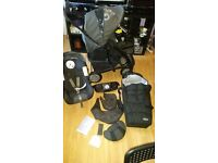 Graco quattro tour deluxe travel system with car seat and carrycot