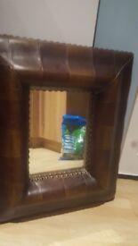 Brown studded mirror